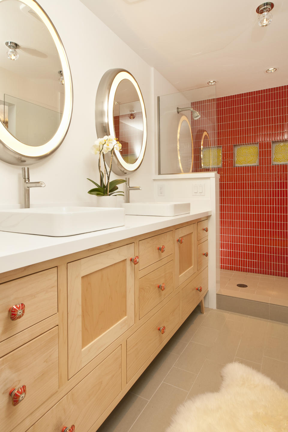cool bathroom brings the design of a fifties automobile hop into your design. The brilliant red-tile in the stand-alone shower is the space's focal point, and it is completely triggered with the canary yellow flower tiles.