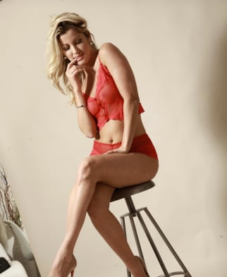 Hot girl sitting on stall with red lingerie