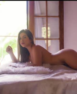 Stunning Latino lying on bed
