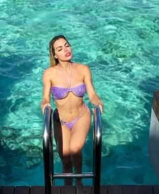 Latino Girl climbing out of the water in bikini