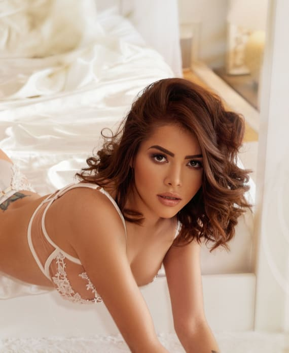 Valentina Lying on bed with white lingerie