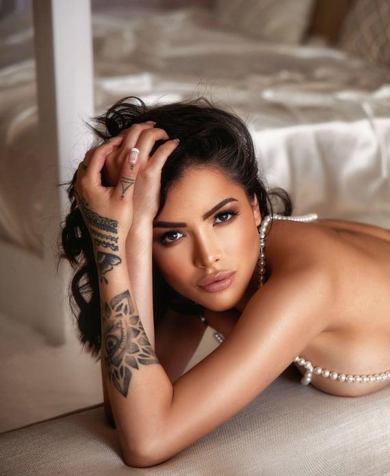 Latino Girl Showing off Tattoos