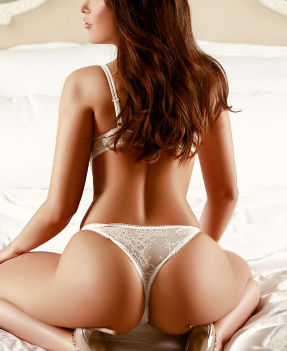 sitting backwards in white knickers
