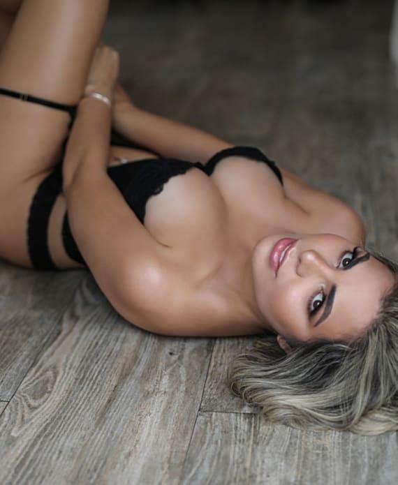Stunning Blonde Lying on the Floor in Black Lingerie
