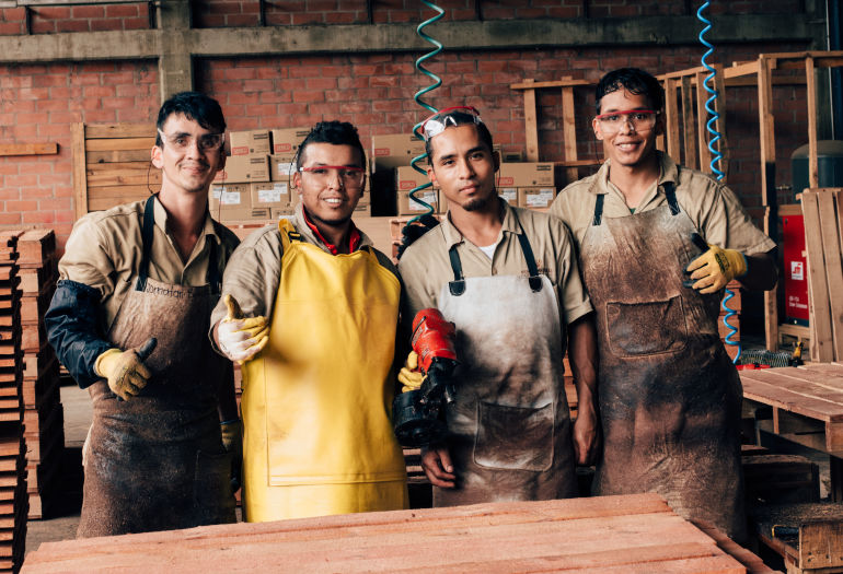Four young workers of Mundo Maderas
