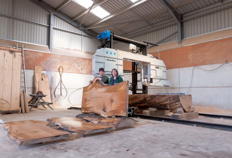Sandy Crook and wife posing with WM1000 Industrial Sawmill in Scotland