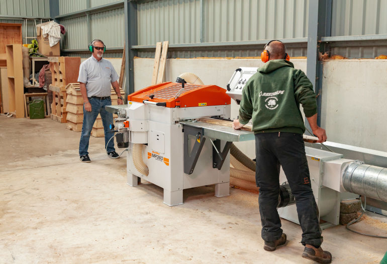 Two men planing wood on Wood-Mizer MP360 Planer Moulder