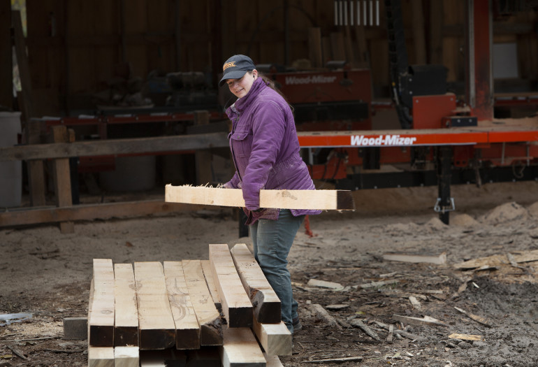 Megan from Holland Timber Company moving dimensioned boards