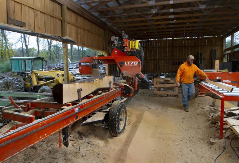 Luke with Wood-Mizer LT70 Wide sawmill operation