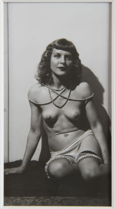 Untitled (Marie with ruffled stockings, white background) by Eugene Von Bruenchenhein