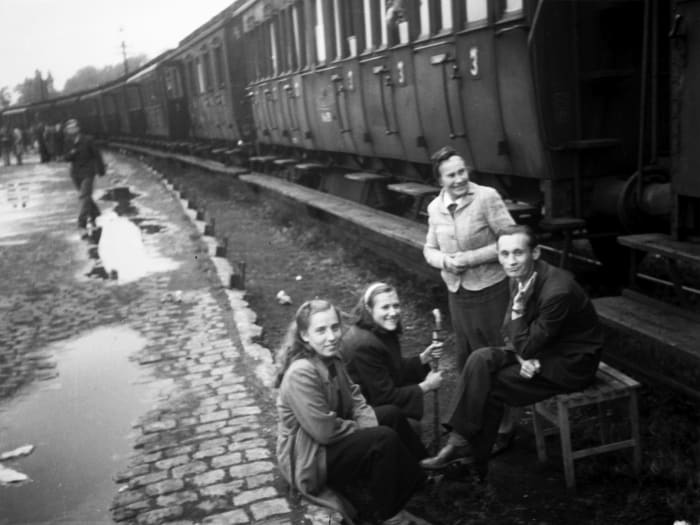 Kassel railroad station, waiting to be transported to another camp, 1948 by Jonas Mekas