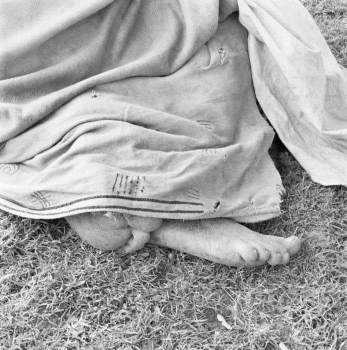 Woman resting at the trading store, Hobeni, Bomvanaland, Transkei by David Goldblatt