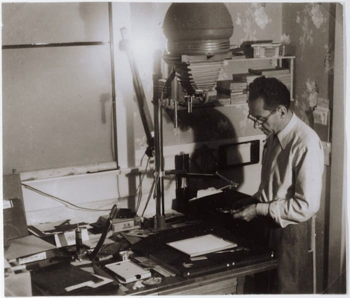 Man Ray in his Darkroom by Man Ray