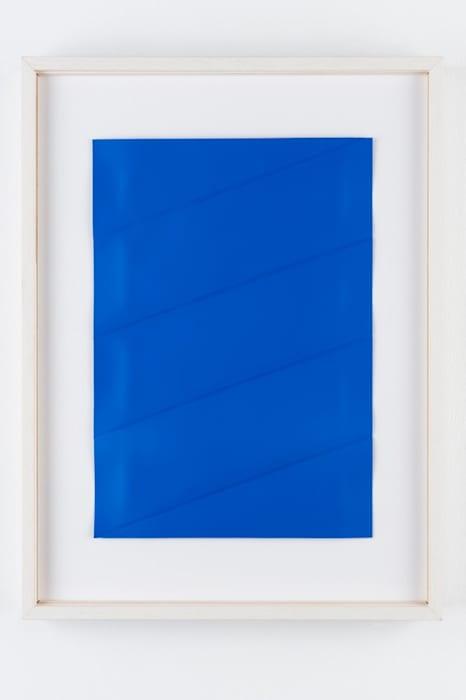 Blue plastic sheet by Charlotte Posenenske