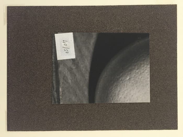 Untitled (Ostrich Egg with stamp and sandpaper) by Man Ray