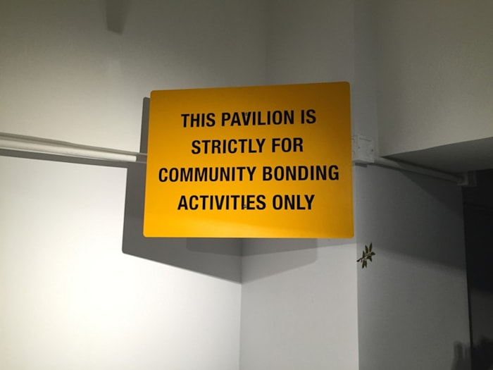 THIS PAVILION IS STRICTLY FOR COMMUNITY BONDING ACTIVITIES ONLY by Heman Chong