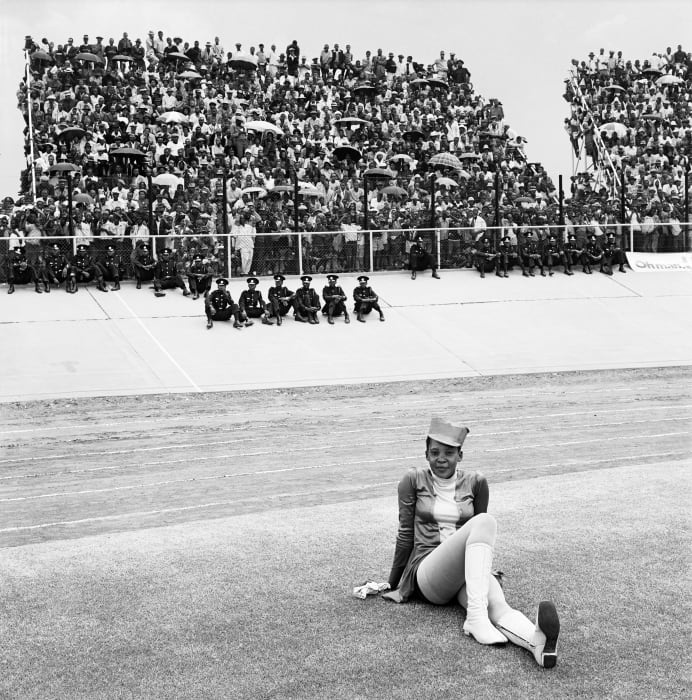 Drum majorette, Cup final, Orlando Stadium, Soweto. 1972 by David Goldblatt