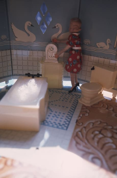 First Bathroom/Woman Standing/Vertical by Laurie Simmons
