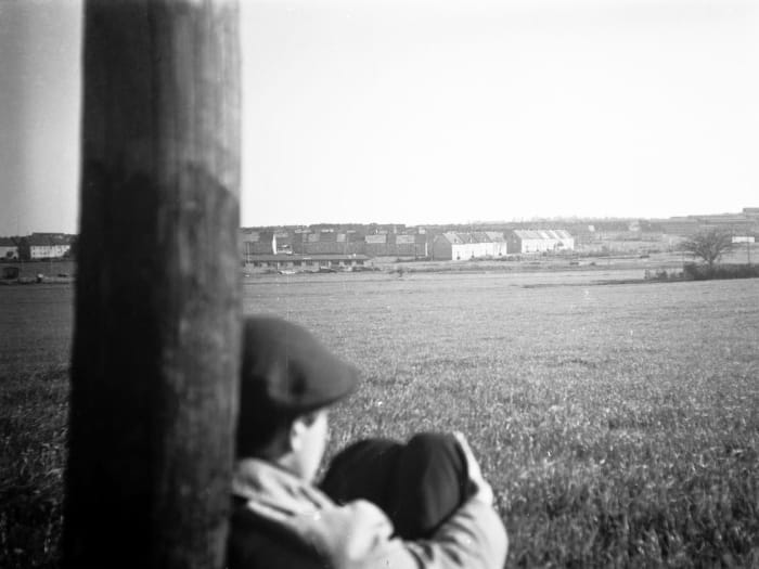 My brother Adolfas looking over the Kassel/Mattenberg D.P. Camp by Jonas Mekas