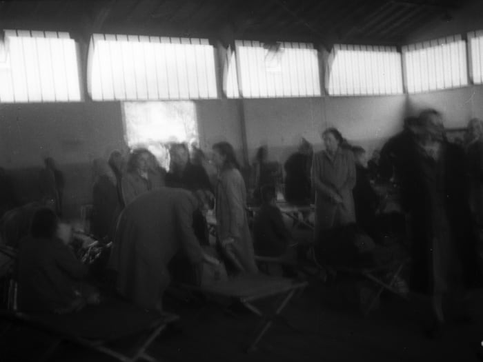 A new transport of displaced persons arrives in Wiesbaden D.P. Camp, 1945 by Jonas Mekas