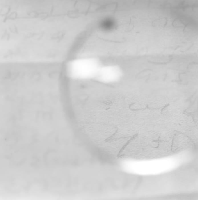 Gandhi's Glasses - Viewing a note written on his 'day of silence' shortly before his death. by Tomoko Yoneda
