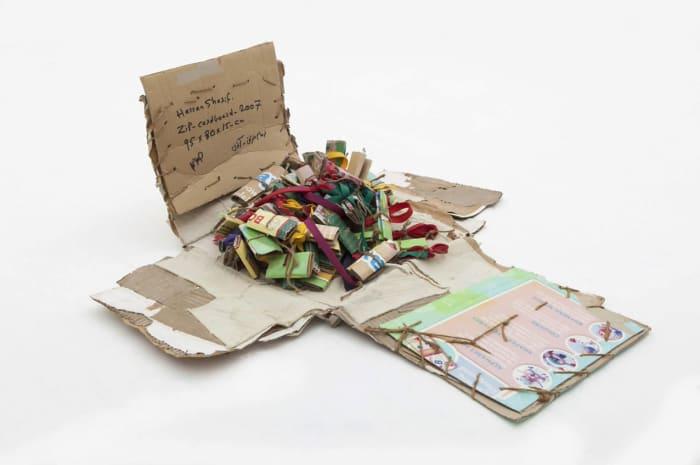 Zip & Cardboard by Hassan Sharif