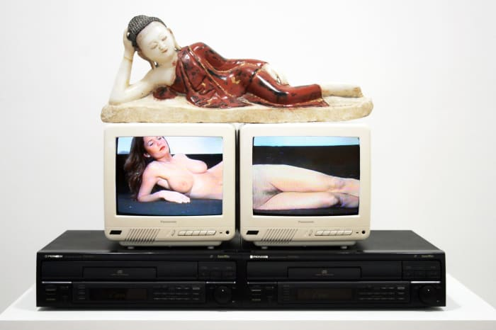 Reclining Buddha by Nam June Paik
