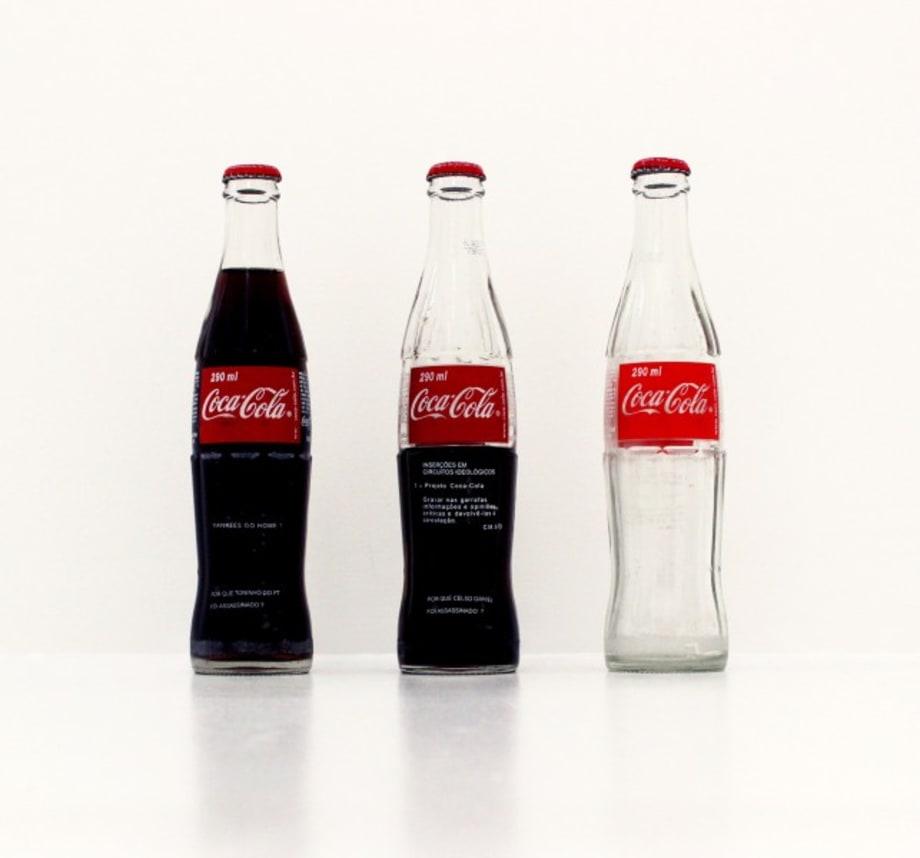 Inserções em circuitos ideológicos: Projeto Coca-Cola (Insertions in ideological circuits: Coca-Cola Project) by Cildo Meireles