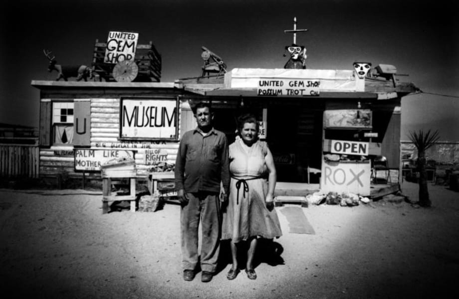 Call and Ruby Black in front of their museum, Mojave Desert, USA by Ed van der Elsken