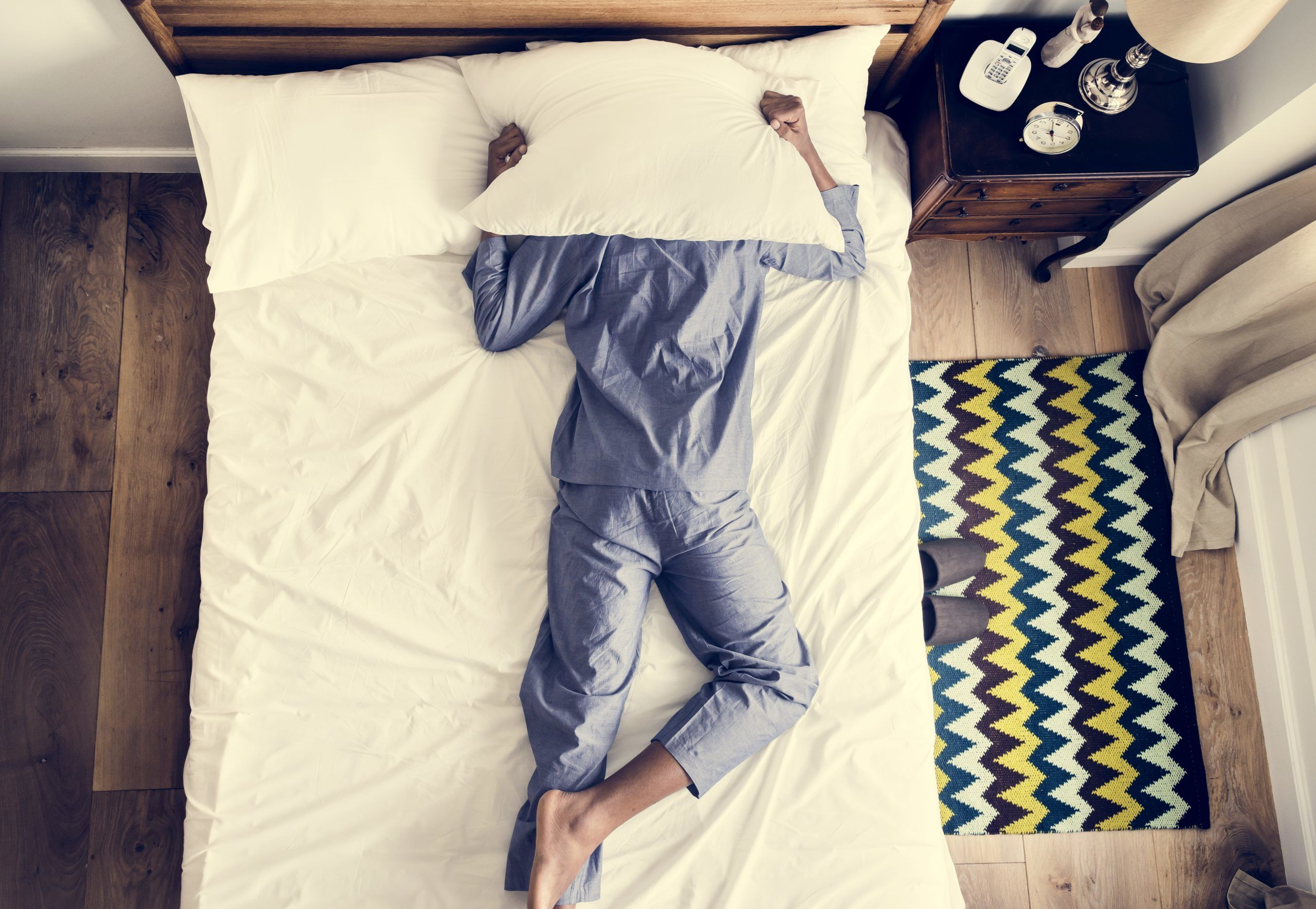 Man with sleep apnea on bed