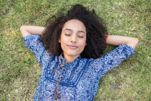 Young woman napping in park