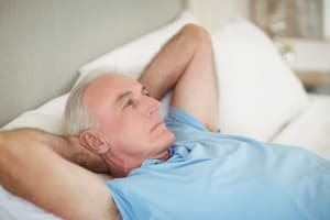 Man in bed daydreaming