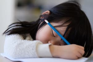 child falling asleep during school