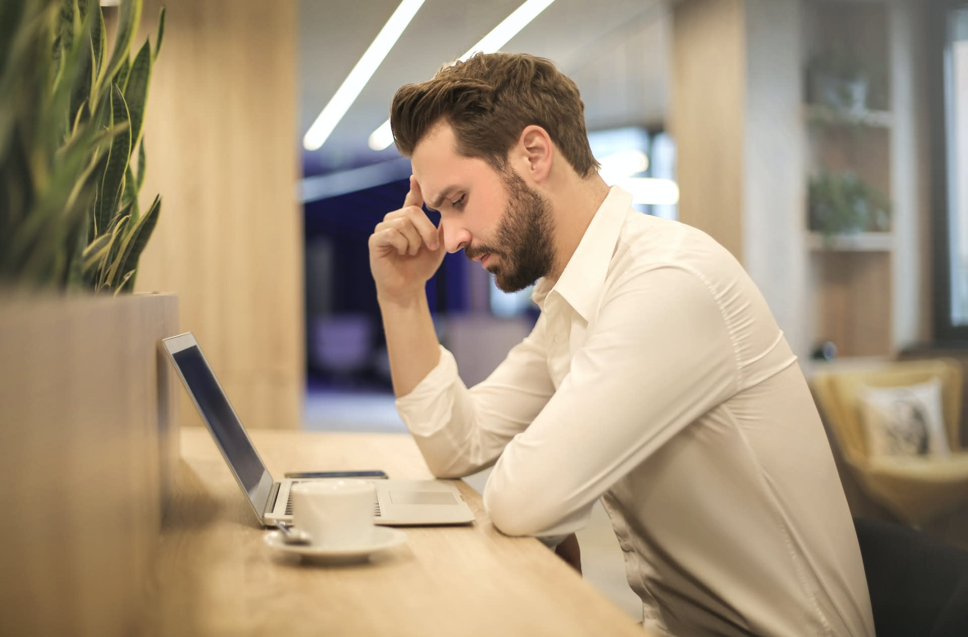 Man working and wishing he could take a nap