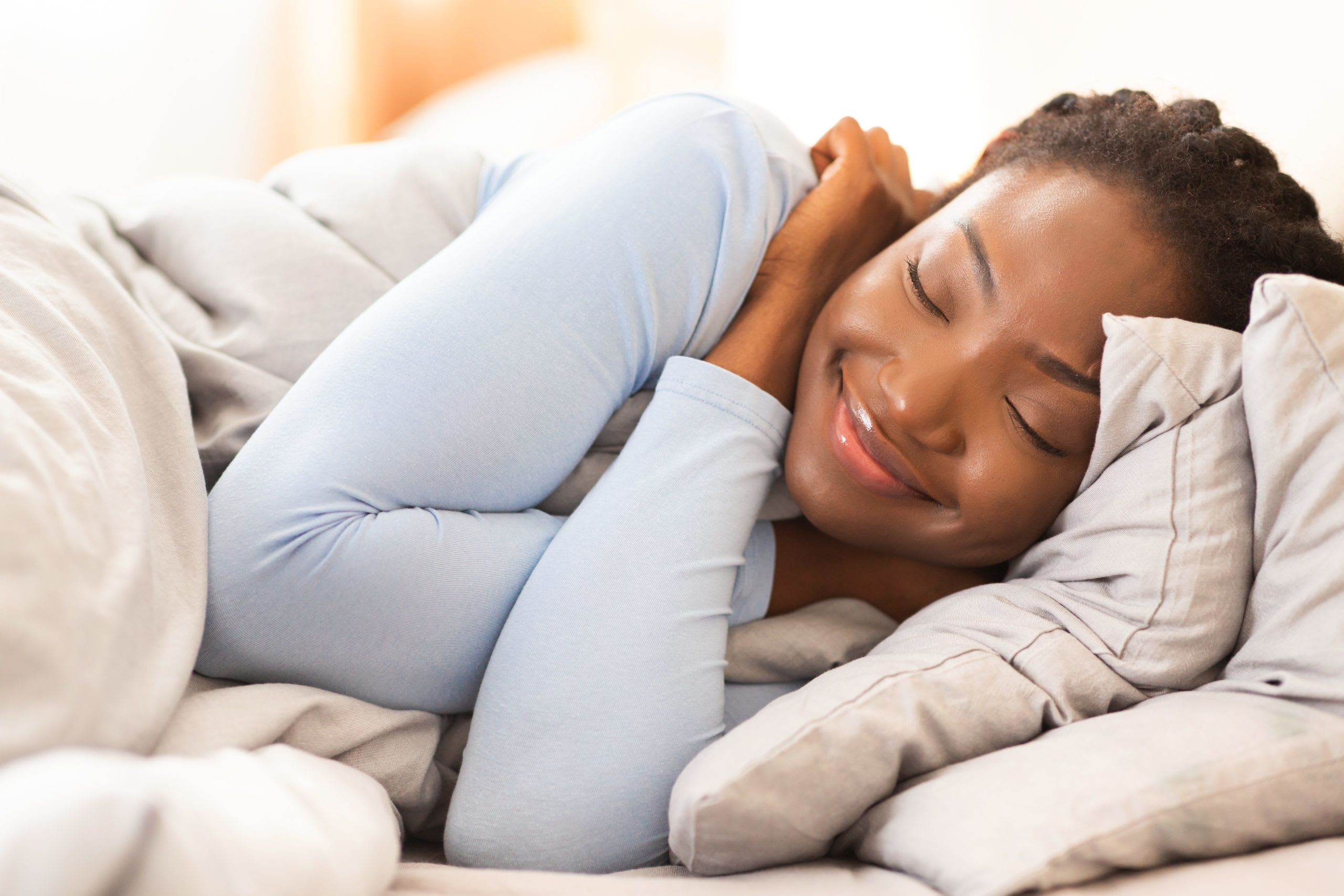 Woman smiling and dreaming