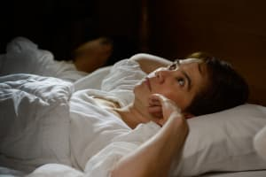 Woman with insomnia can not sleep at night