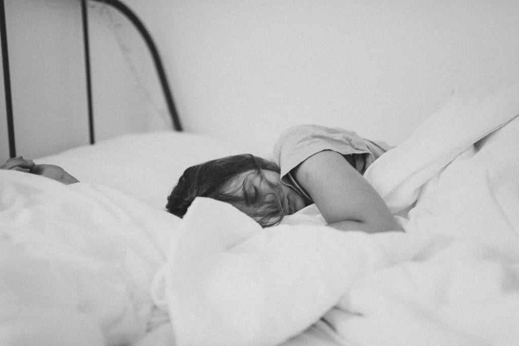 woman suffering with Obstructive Sleep Apnea
