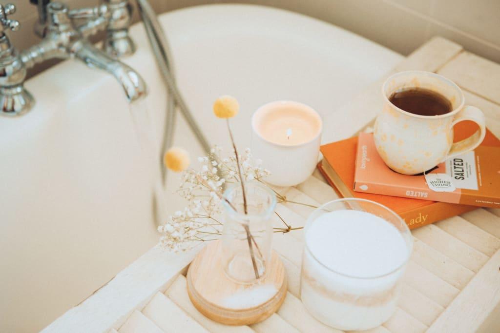 Books, coffee, candle for a nice bath