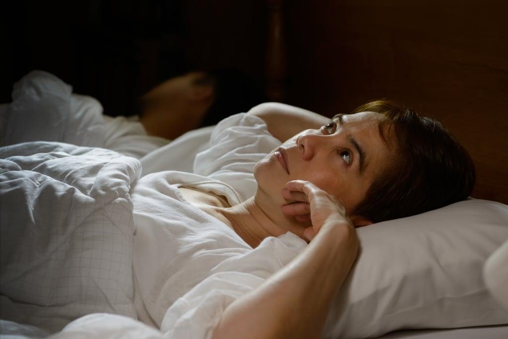woman lying awake
