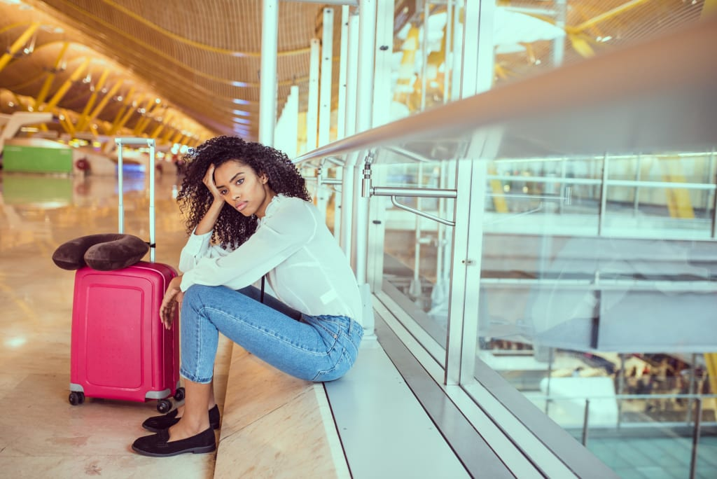 woman suffering with jet lag at airport