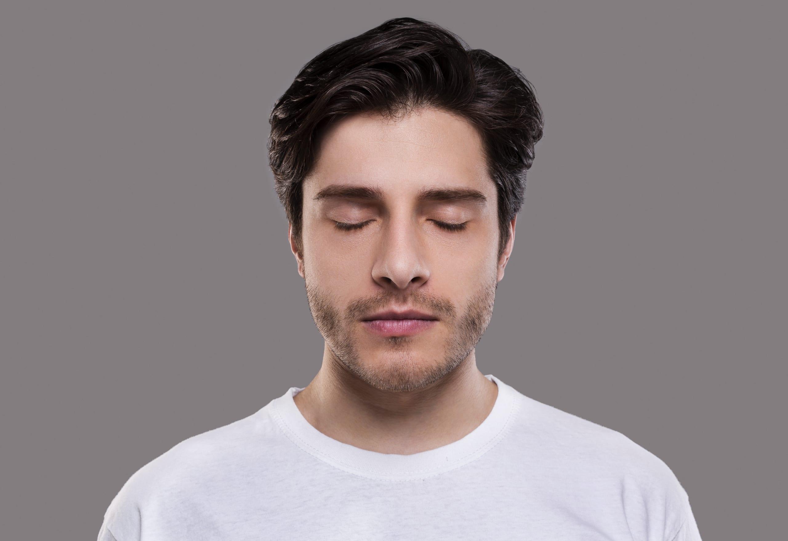man happily having a lucid dream