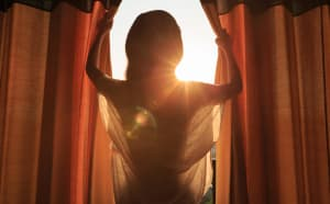 woman standing in morning day light