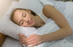 lady sleeping and smiling