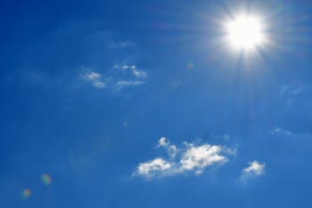 Blue Sky and Bright Sun lit Rays