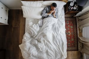 man with lack of sleep on the bed