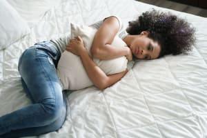 Depressed Woman Lying on Mattress