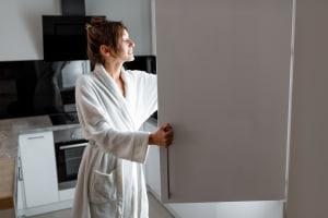 Woman opening fridge