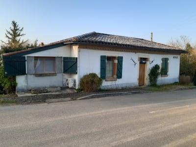 Maison de Type 2 avec jardin.