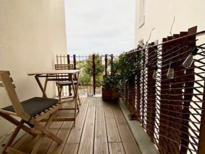 Appartement récent balcon et parking