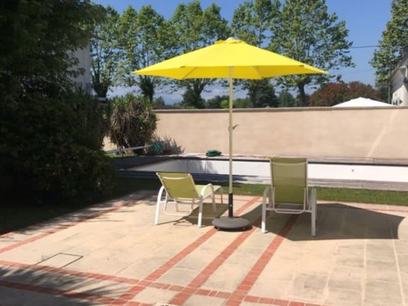 Sale house / villa Laloubere 395000€ - Picture 4
